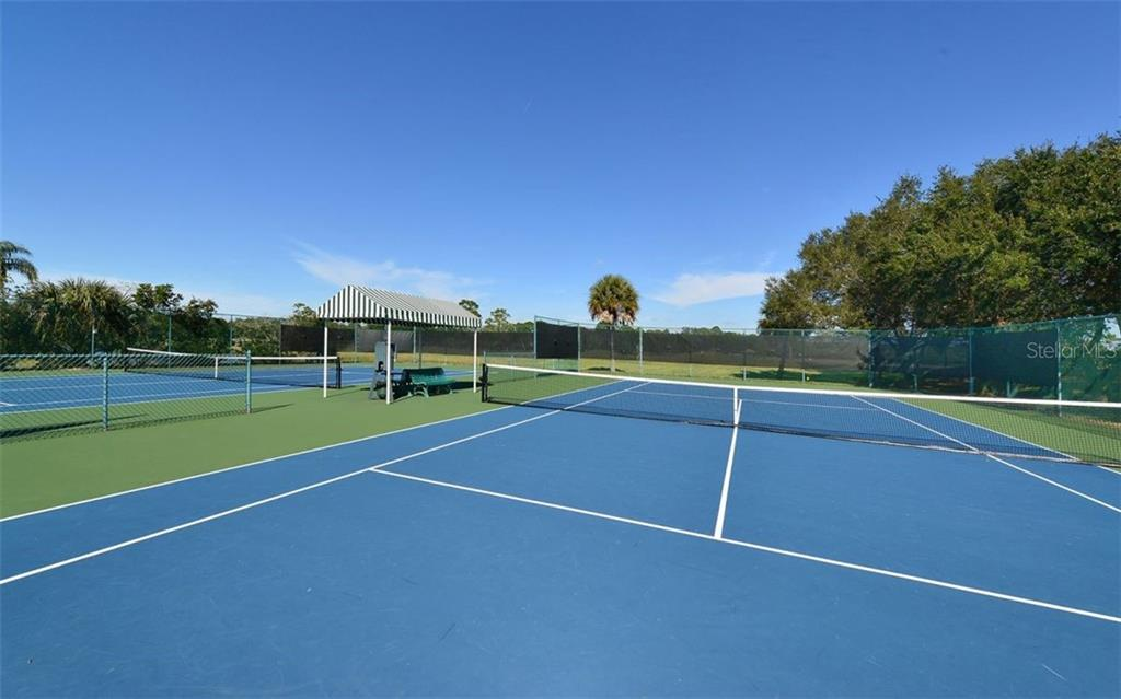 Tennis courts - Single Family Home for sale at 953 Chickadee Dr, Venice, FL 34285 - MLS Number is N6111180