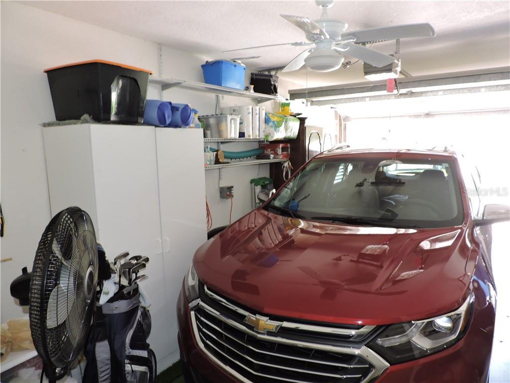 Garage with work bench and storage - Condo for sale at 1041 Capri Isles Blvd #121, Venice, FL 34292 - MLS Number is N6112042