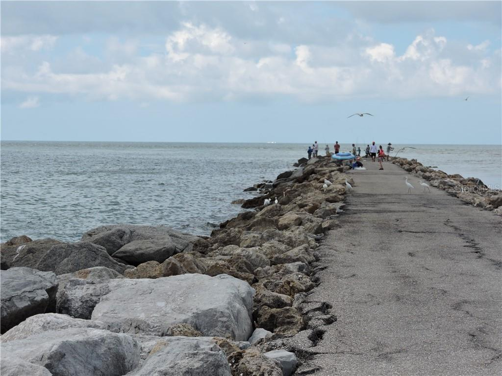 Venice Pier for fishing, bird and boat watching and ENJOYING sunsets - Condo for sale at 1041 Capri Isles Blvd #121, Venice, FL 34292 - MLS Number is N6112042