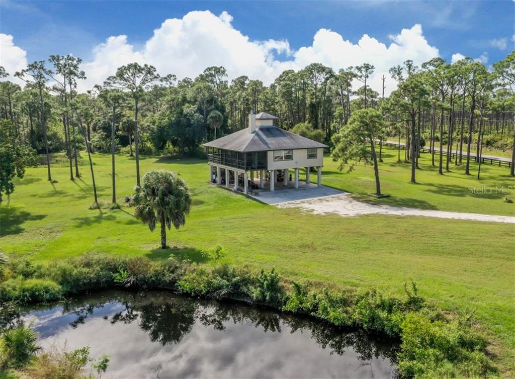 Aerial - Single Family Home for sale at 9425 Myakka Dr, Venice, FL 34293 - MLS Number is N6112567