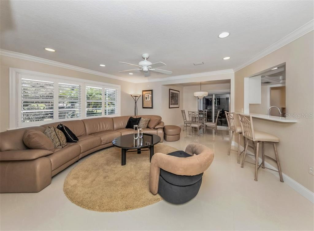 Family room, dinette - Single Family Home for sale at 1321 Guilford Dr, Venice, FL 34292 - MLS Number is N6113272