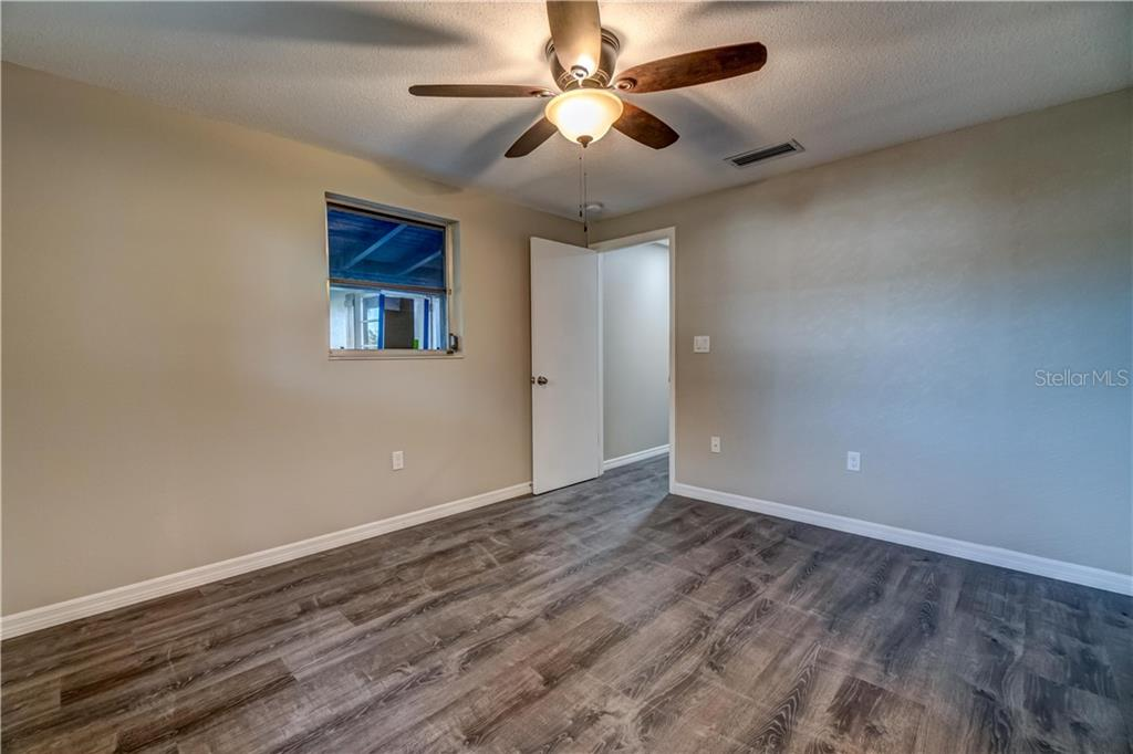 Front Bedroom - Single Family Home for sale at 607 Garden Rd, Venice, FL 34293 - MLS Number is N6113347