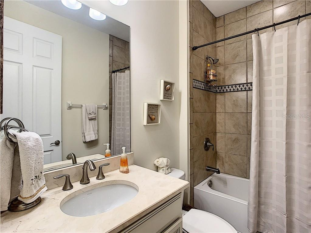 Guest bathroom - Single Family Home for sale at 108 Maraviya Blvd, North Venice, FL 34275 - MLS Number is N6113946