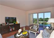 Great room - Virtually Staged - Condo for sale at 167 Tampa Ave E #513, Venice, FL 34285 - MLS Number is N5911190