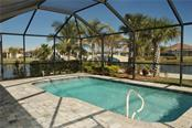 view from outside your lanai - Single Family Home for sale at 19261 Isadora St, Venice, FL 34293 - MLS Number is N5911485