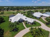 Aerial front view of house - Single Family Home for sale at 447 Sherbrooke Ct, Venice, FL 34293 - MLS Number is N5912771