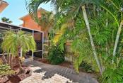 Patio to lanai - Condo for sale at 501 Barcelona Ave #c, Venice, FL 34285 - MLS Number is N5913183