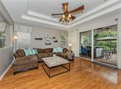 Family room to lanai - Single Family Home for sale at 11759 Puma Path, Venice, FL 34292 - MLS Number is N5913611