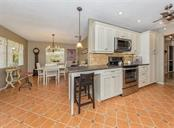 Kitchen to dining room - Single Family Home for sale at 925 Harbor Dr S, Venice, FL 34285 - MLS Number is N5913682