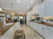 Kitchen to dinette - Single Family Home for sale at 20122 Passagio Dr, Venice, FL 34293 - MLS Number is N5914419