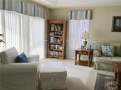 Large light and bright and warm family room with sliders to the pool/ lanai - Single Family Home for sale at 4265 Irdell Ter, North Port, FL 34288 - MLS Number is N5915255