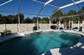 Happiness is enjoying your pool - Single Family Home for sale at 4265 Irdell Ter, North Port, FL 34288 - MLS Number is N5915255