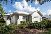 Front of home with lovely pathway to covered front door - Villa for sale at 611 Crossfield Cir #25, Venice, FL 34293 - MLS Number is N5915309