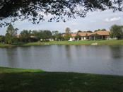 Private lake views and mature oak in back yard - Villa for sale at 1445 Maseno Dr, Venice, FL 34292 - MLS Number is N5916837