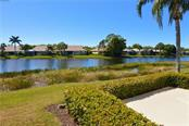 Patio/lake view - Condo for sale at 903 Addington Ct #102, Venice, FL 34293 - MLS Number is N5916962
