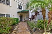 Walkway to elevators - Condo for sale at 3730 Cadbury Cir #420, Venice, FL 34293 - MLS Number is N5916974