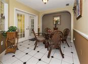 Kitchen nook with French doors leading to the lanai and pool. - Single Family Home for sale at 620 Valencia Rd, Venice, FL 34285 - MLS Number is N6100912