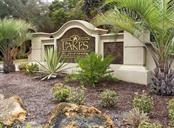 Community sign - Single Family Home for sale at 627 Lakescene Dr, Venice, FL 34293 - MLS Number is N6103268
