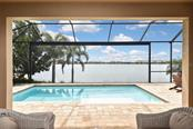 Pool with lake view - Single Family Home for sale at 166 Toscavilla Blvd, Nokomis, FL 34275 - MLS Number is N6105654