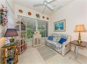 Living room with slider to lanai - Villa for sale at 1230 Berkshire Cir, Venice, FL 34292 - MLS Number is N6105831