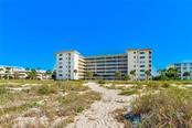 Aerial - Condo for sale at 1150 Tarpon Center Dr #203, Venice, FL 34285 - MLS Number is N6108842