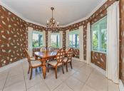 Spacious dining room with room for 8 or more. - Single Family Home for sale at 727 Eagle Point Dr, Venice, FL 34285 - MLS Number is N6110087