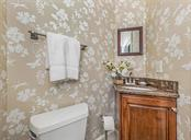 Half Bath for guests - Single Family Home for sale at 727 Eagle Point Dr, Venice, FL 34285 - MLS Number is N6110087