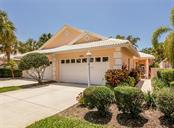 Front with walkway to side entrance - Villa for sale at 1244 Berkshire Cir, Venice, FL 34292 - MLS Number is N6110278