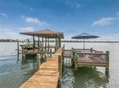 Covered boat slip and lounge area - Single Family Home for sale at 2208 Casey Key Rd, Nokomis, FL 34275 - MLS Number is N6110959
