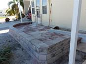 Still working on the patio, but will be completed very soon as well as the lanai - Single Family Home for sale at 707 S Green Cir #71, Venice, FL 34285 - MLS Number is N6111316