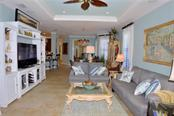 Living room to dining room - Villa for sale at 20117 Tesoro Dr, Venice, FL 34293 - MLS Number is N6111641