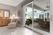 Master bedroom with sliders to lanai - Single Family Home for sale at 725 Eagle Point Dr, Venice, FL 34285 - MLS Number is N6111842