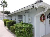 Side of Clubhouse - Condo for sale at 1041 Capri Isles Blvd #121, Venice, FL 34292 - MLS Number is N6112042