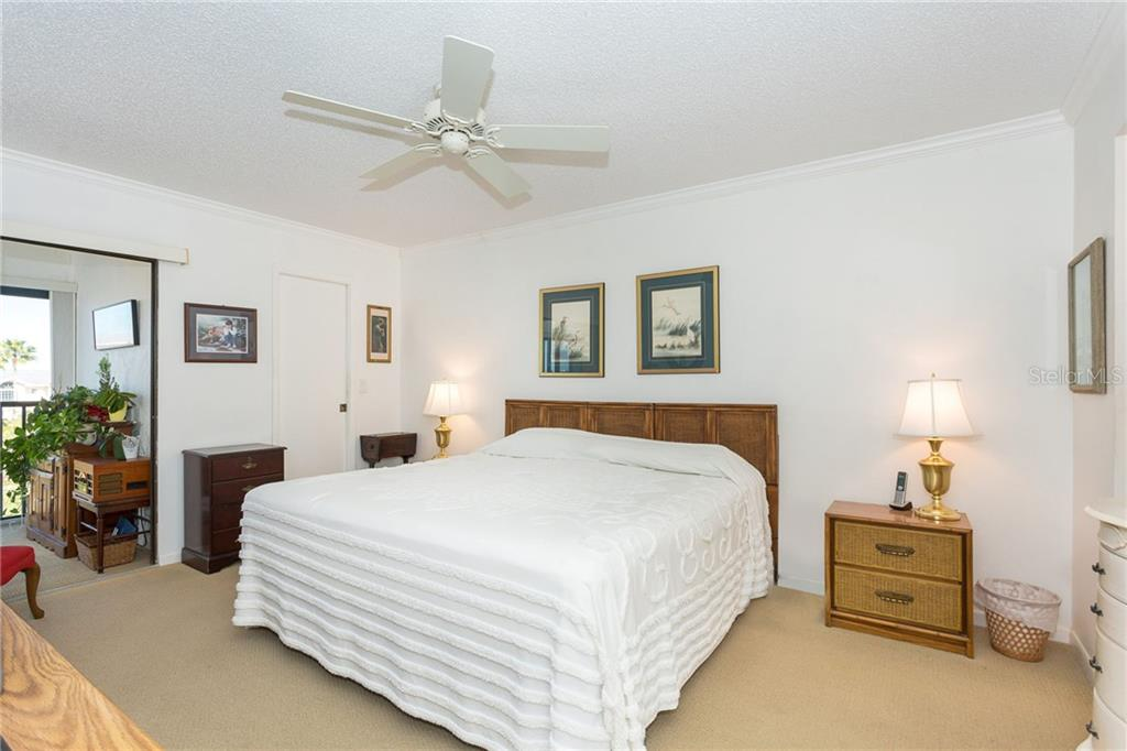 Large master bedroom with large walk-in closet - Condo for sale at 1551 Beach Rd #412, Englewood, FL 34223 - MLS Number is D6110828