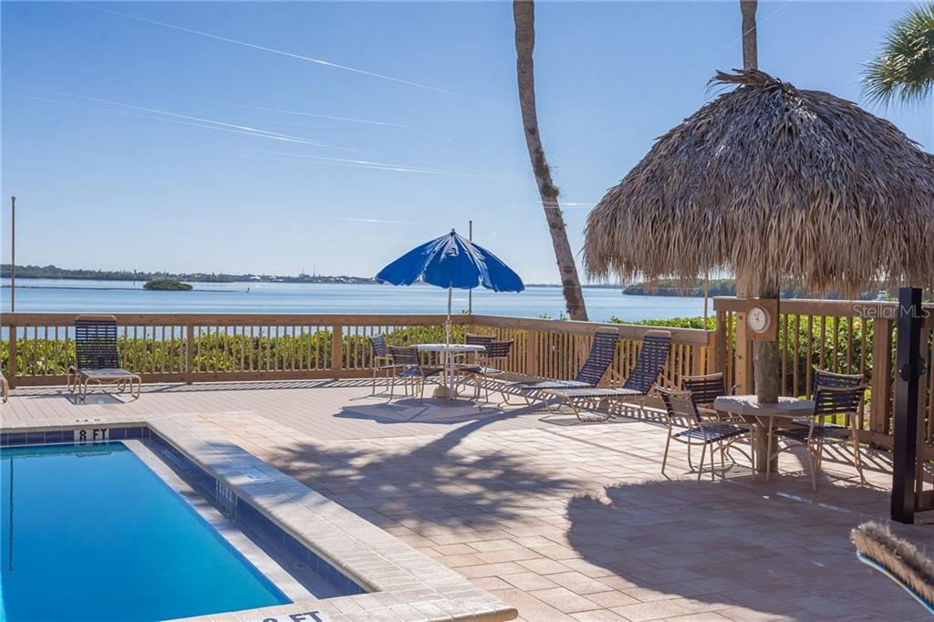 One of the heated, Bayfront pools - Condo for sale at 1551 Beach Rd #412, Englewood, FL 34223 - MLS Number is D6110828