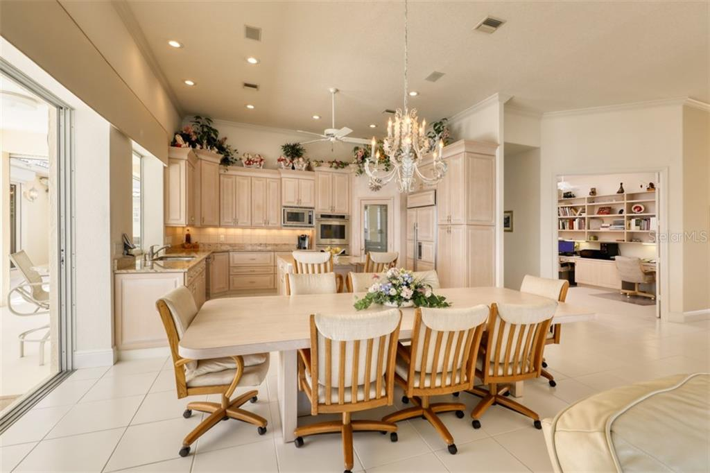 DINING ROOM AND KITCHEN - Single Family Home for sale at 6793 Manasota Key Rd, Englewood, FL 34223 - MLS Number is D6112093