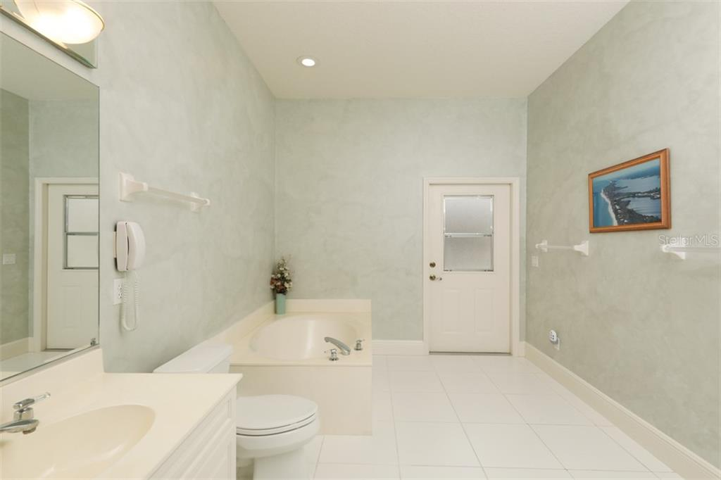 GUEST BATH - Single Family Home for sale at 6793 Manasota Key Rd, Englewood, FL 34223 - MLS Number is D6112093