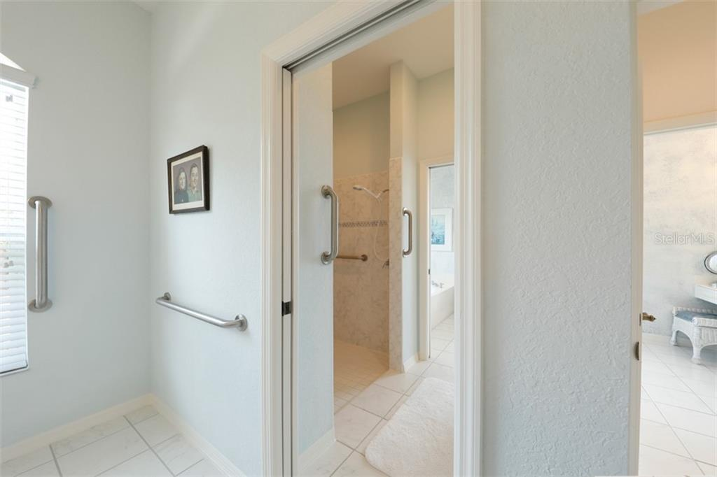 1ST MASTER BATH - Single Family Home for sale at 6793 Manasota Key Rd, Englewood, FL 34223 - MLS Number is D6112093