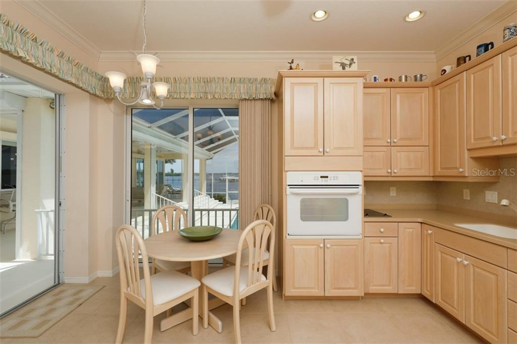 GUEST HOUSE EATING AREA AND KITCHEN - Single Family Home for sale at 6793 Manasota Key Rd, Englewood, FL 34223 - MLS Number is D6112093
