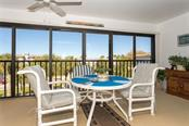 Covered lanai with the option to open the sliding door and let the Bay breeze in. - Condo for sale at 1551 Beach Rd #412, Englewood, FL 34223 - MLS Number is D6110828