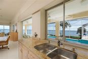 VIEW FROM THE KITCHEN - Single Family Home for sale at 6793 Manasota Key Rd, Englewood, FL 34223 - MLS Number is D6112093