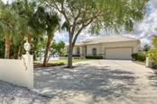 EXTERIOR FRONT - Single Family Home for sale at 6793 Manasota Key Rd, Englewood, FL 34223 - MLS Number is D6112093