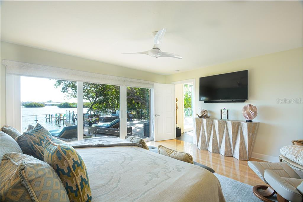 Master Bedroom with access to deck and bay views - Single Family Home for sale at 140 N Casey Key Rd, Osprey, FL 34229 - MLS Number is T3228618