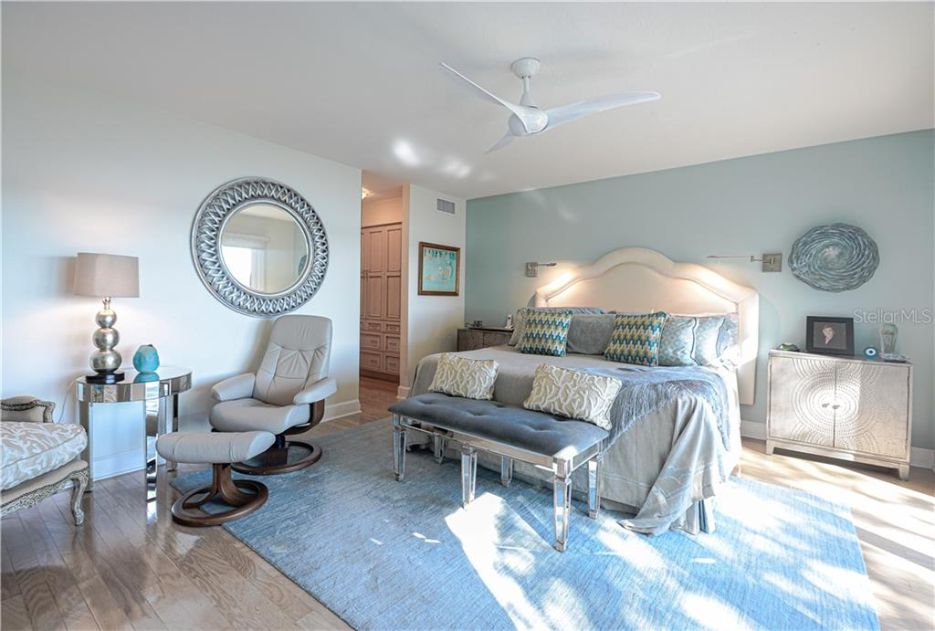 Master bedroom with en suite shower and vanity bath. - Single Family Home for sale at 140 N Casey Key Rd, Osprey, FL 34229 - MLS Number is T3228618