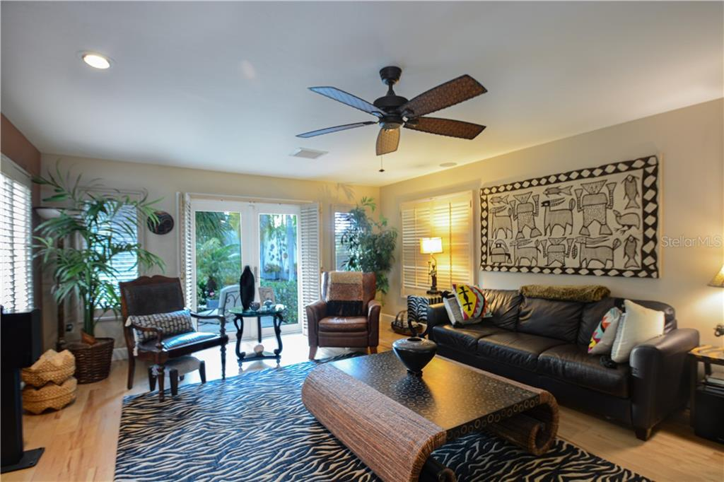 Second Bedroom being used as a media room.  It is located on the first floor and has a private porch beyond the french doors. - Single Family Home for sale at 140 N Casey Key Rd, Osprey, FL 34229 - MLS Number is T3228618