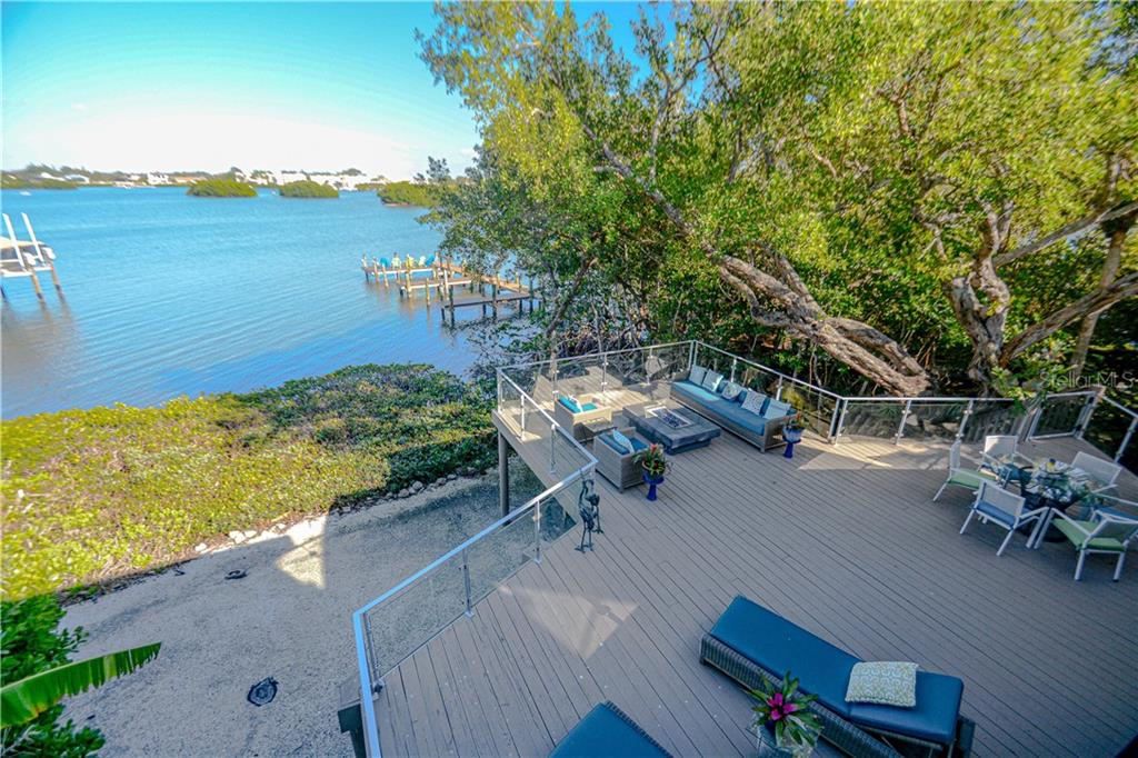 Rear deck of home with views to bay and deeded dock - Single Family Home for sale at 140 N Casey Key Rd, Osprey, FL 34229 - MLS Number is T3228618