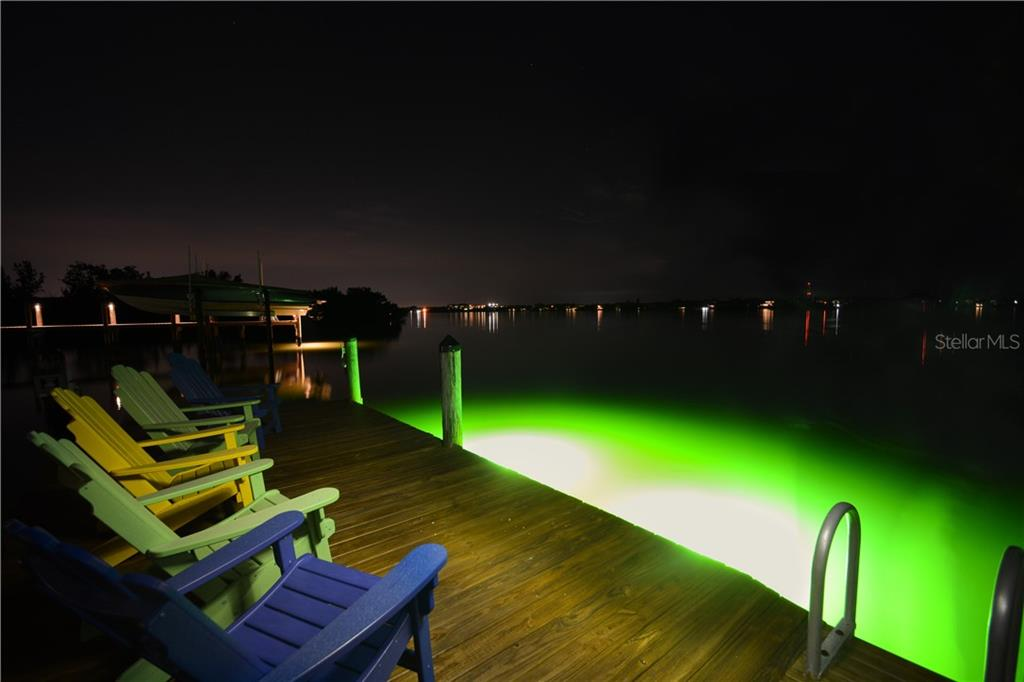 Deeded dock with night lights looking back to the mainland from Casey Key - Single Family Home for sale at 140 N Casey Key Rd, Osprey, FL 34229 - MLS Number is T3228618