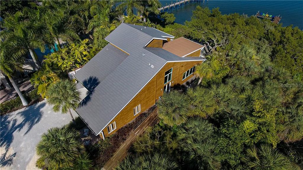 Aerial view of home with deeded dock.  Two story main entrance on side of home - Single Family Home for sale at 140 N Casey Key Rd, Osprey, FL 34229 - MLS Number is T3228618
