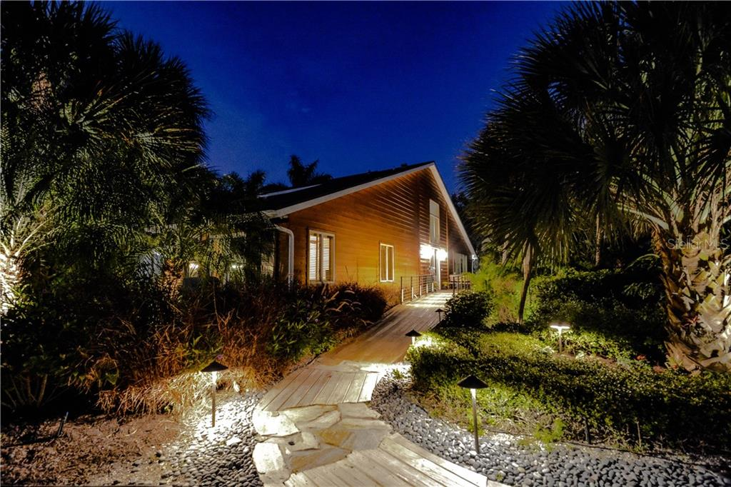Beautiful landscaping and night lights - Single Family Home for sale at 140 N Casey Key Rd, Osprey, FL 34229 - MLS Number is T3228618