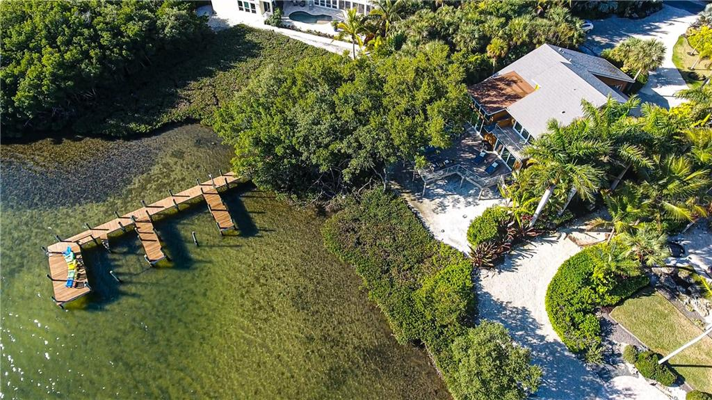 Aerial view of home and deeded dock - Single Family Home for sale at 140 N Casey Key Rd, Osprey, FL 34229 - MLS Number is T3228618
